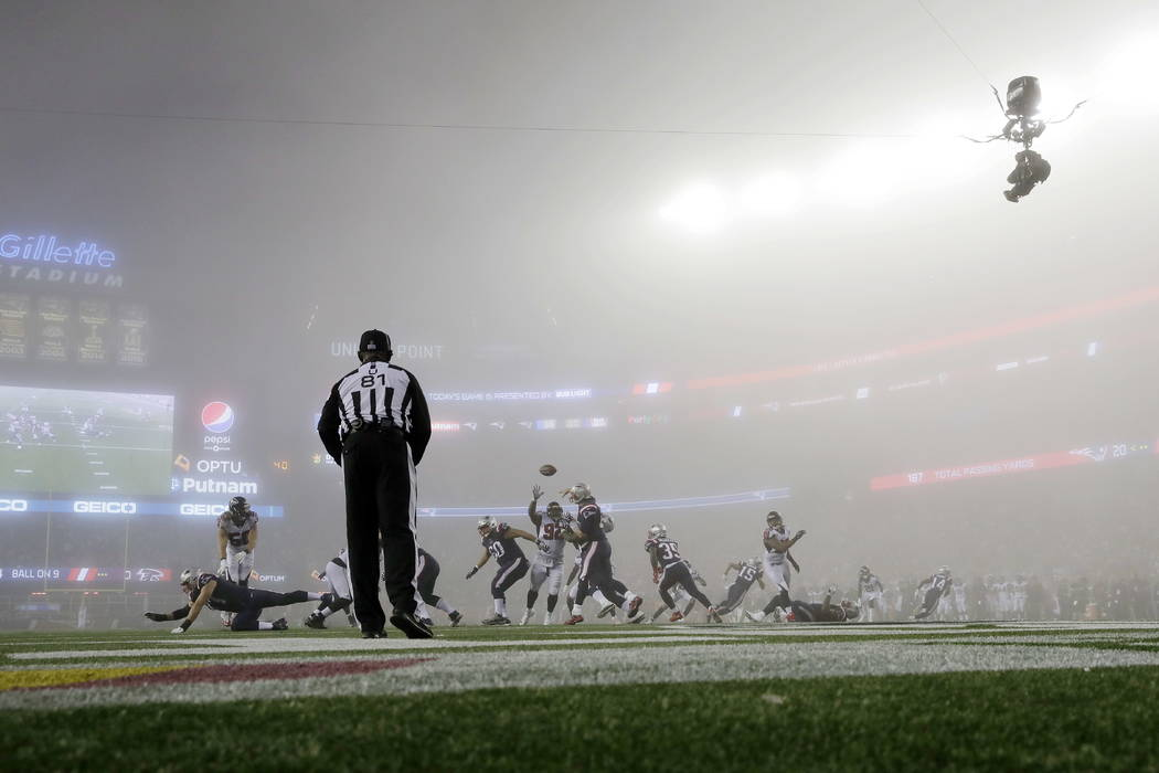 New England Patriots quarterback Tom Brady, center, passes in the fog against the Atlanta Falcons during the second half of an NFL football game, Sunday, Oct. 22, 2017, in Foxborough, Mass. (AP Ph ...