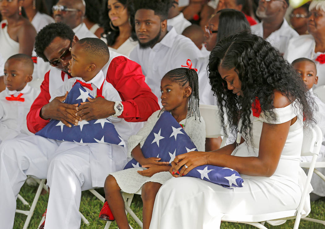 Myeshia Johnson, right, widow of U.S. Army Sergeant La David Johnson, who was among four special forces soldiers killed in Niger, sits with her daughter, Ah'Leeysa Johnson, and son Le David Johnso ...