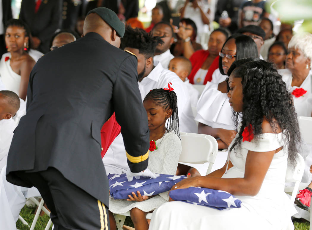 Myeshia Johnson, right, widow of U.S. Army Sergeant La David Johnson, who was among four special forces soldiers killed in Niger, sits with her daughter, Ah'Leeysa Johnson who was presented with a ...