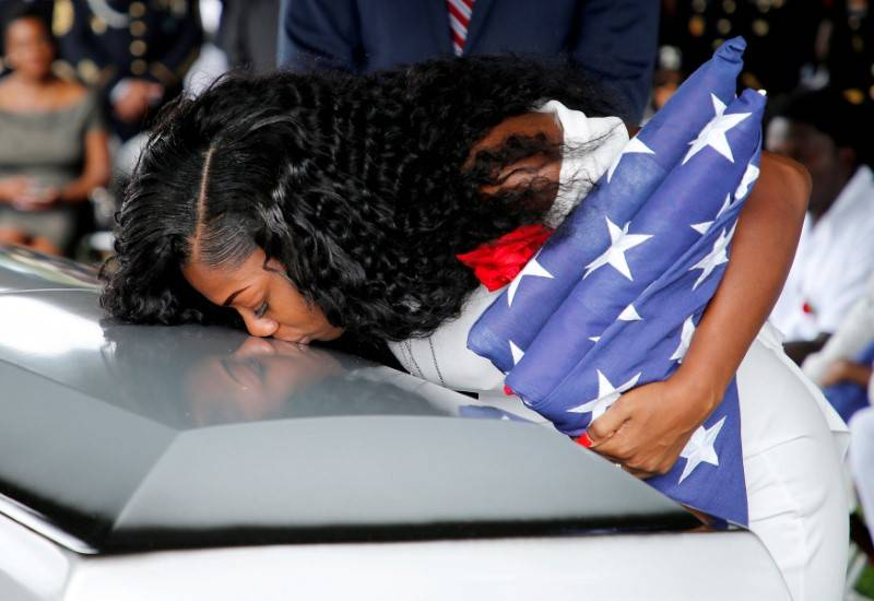 Myeshia Johnson, wife of U.S. Army Sergeant La David Johnson, who was among four special forces soldiers killed in Niger, kisses his coffin at a graveside service in Hollywood, Florida, Oct. 21, 2 ...