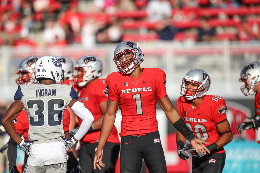 UNLV Rebels quarterback Armani Rogers (1), right, after scoring a touchdown against the Utah State Aggies during the second quarter of a football game at Sam Boyd Stadium in Las Vegas, Saturday, O ...
