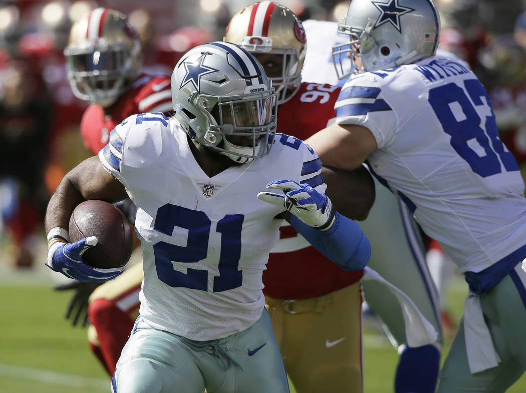 Dallas Cowboys running back Ezekiel Elliott (21) runs against the San Francisco 49ers during the first half of an NFL football game in Santa Clara, Calif., Sunday, Oct. 22, 2017. (AP Photo/Eric Ri ...
