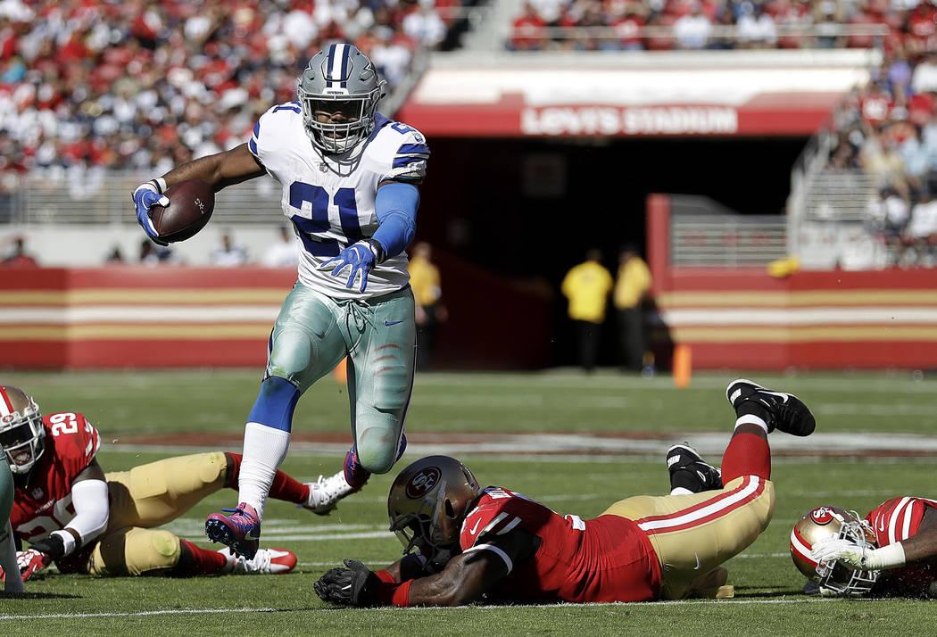 Dallas Cowboys running back Ezekiel Elliott (21) runs against the San Francisco 49ers during the first half of an NFL football game in Santa Clara, Calif., Sunday, Oct. 22, 2017. (AP Photo/Marcio  ...