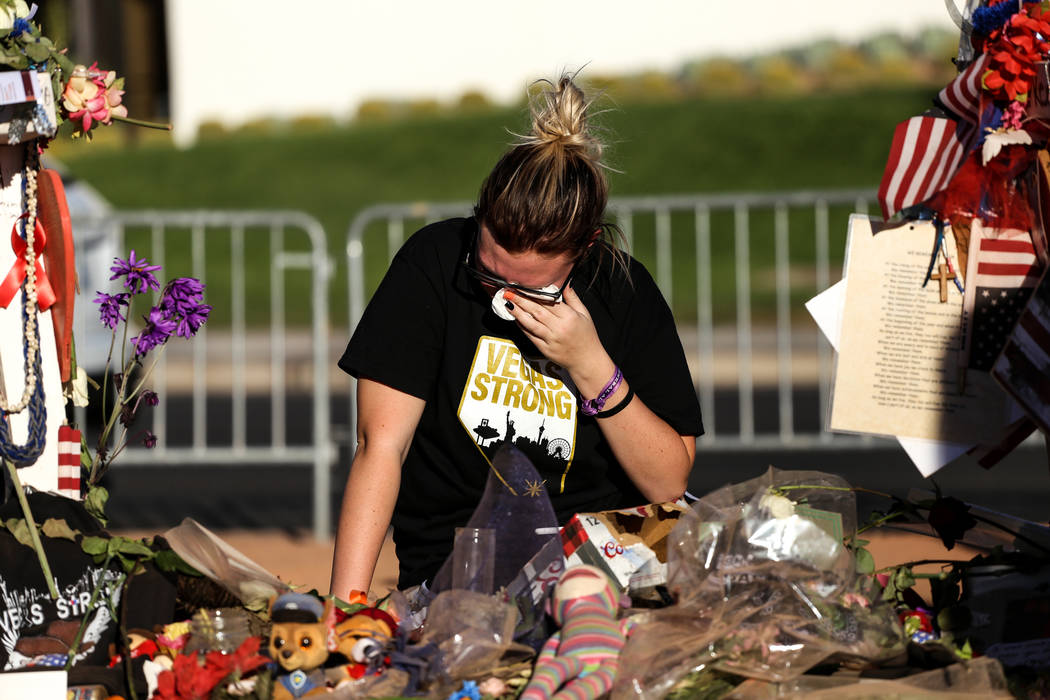 Kamryn Trubey, 18, of Las Vegas, cries at a memorial set up at the Welcome to Fabulous Las Vegas sign in Las Vegas, Sunday, Oct. 22, 2017. Joel Angel Juarez Las Vegas Review-Journal @jajuarezphoto