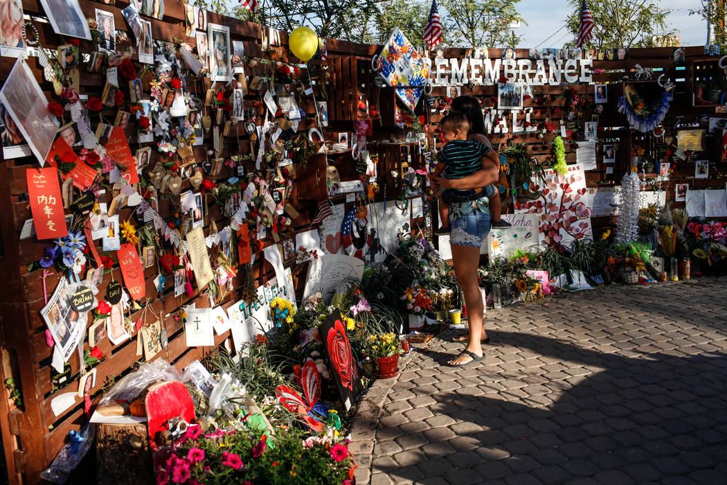 People visit a memorial at the Las Vegas Community Healing Garden in Las Vegas, Monday, Oct. 16, 2017, honoring the victims of the Route 91 Harvest Festival mass shooting. Joel Angel Juarez Las Ve ...