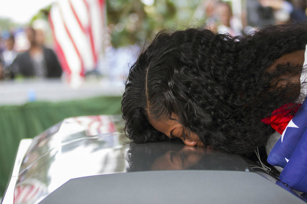 Myeshia Johnson kisses the casket of her husband, Sgt. La David Johnson, during his burial service at Fred Hunter's Hollywood Memorial Gardens in Hollywood, Fla., Saturday, Oct. 21, 2017. La David ...