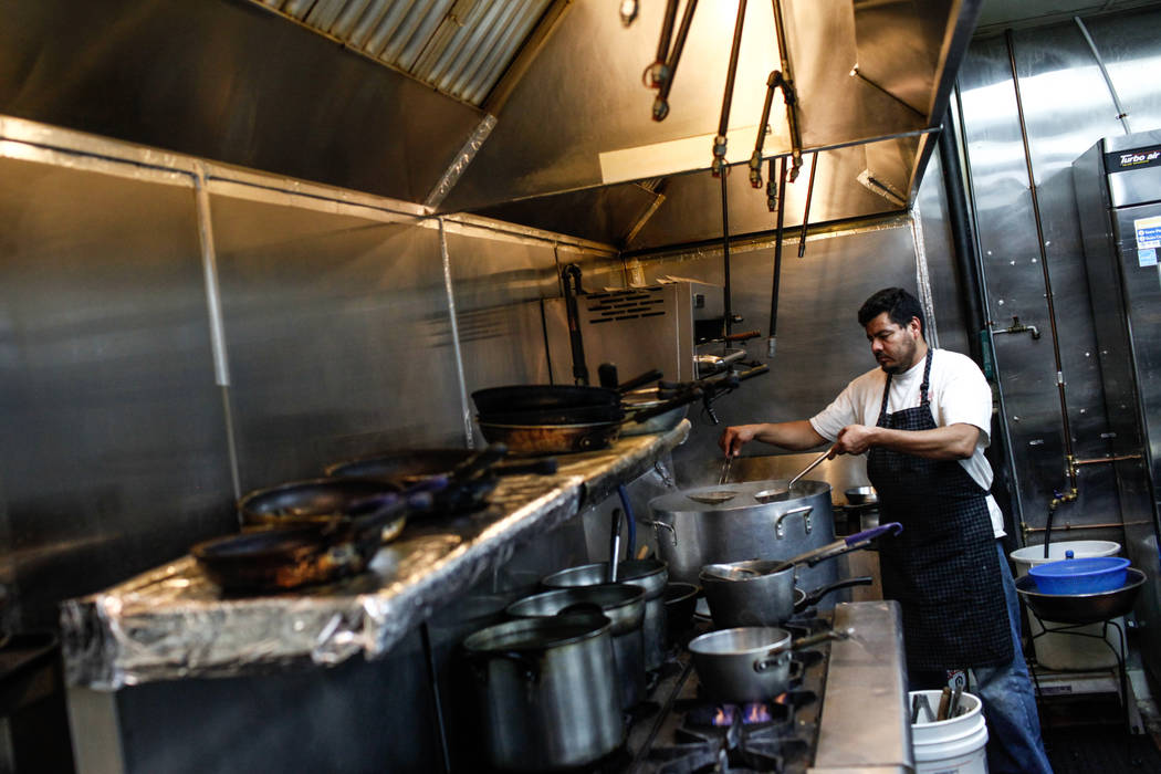Oscar De La Paz, 40, of Las Vegas, cooks at Lee's Korean BBQ in Las Vegas, Tuesday, Oct. 24, 2017. Owner Hae Un Lee attended a meeting Tuesday addressing Asian restaurant owners' concerns about th ...