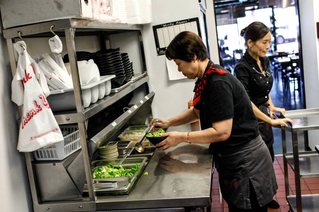 Diane Kook, 50, of Las Vegas, left, prepares vegetables at Lee's Korean BBQ in Las Vegas, Tuesday, Oct. 24, 2017. Owner Hae Un Lee attended a meeting Tuesday addressing Asian restaurant owners' co ...