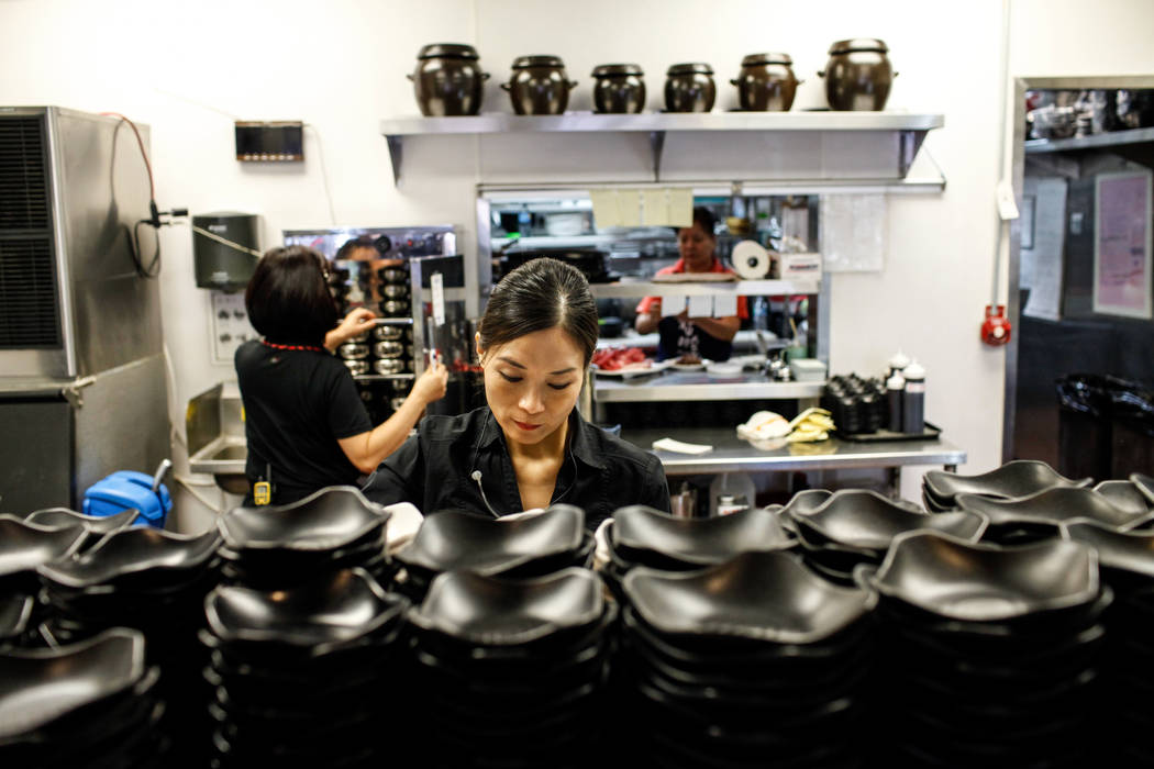 Grace Kim, 48, of Las Vegas, prepares food at Lee's Korean BBQ in Las Vegas, Tuesday, Oct. 24, 2017. Owner Hae Un Lee attended a meeting Tuesday addressing Asian restaurant owners' concerns about  ...