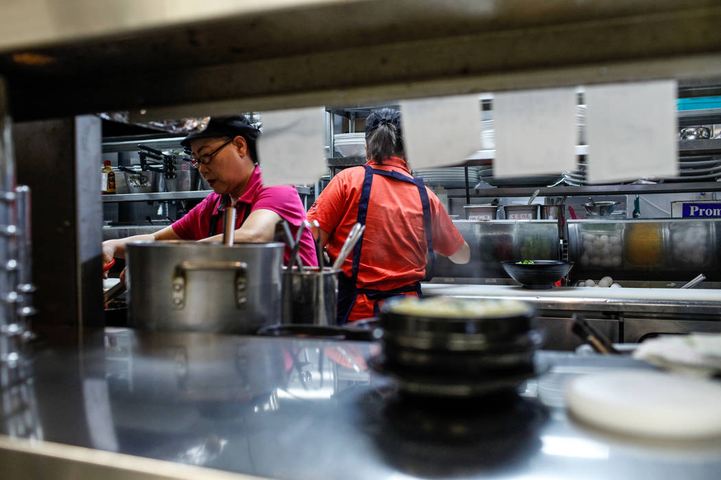 Myung Ja Kim, 59, of Las Vegas, prepares food at Lee's Korean BBQ in Las Vegas, Tuesday, Oct. 24, 2017. Owner Hae Un Lee attended a meeting Tuesday addressing Asian restaurant owners' concerns abo ...