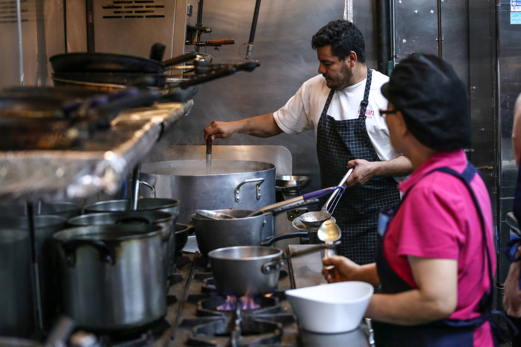 Oscar De La Paz, 40, left, and Myung Ja Kim, 59, right, both of Las Vegas, prepare food at Lee's Korean BBQ in Las Vegas, Tuesday, Oct. 24, 2017. Owner Hae Un Lee attended a meeting Tuesday addres ...