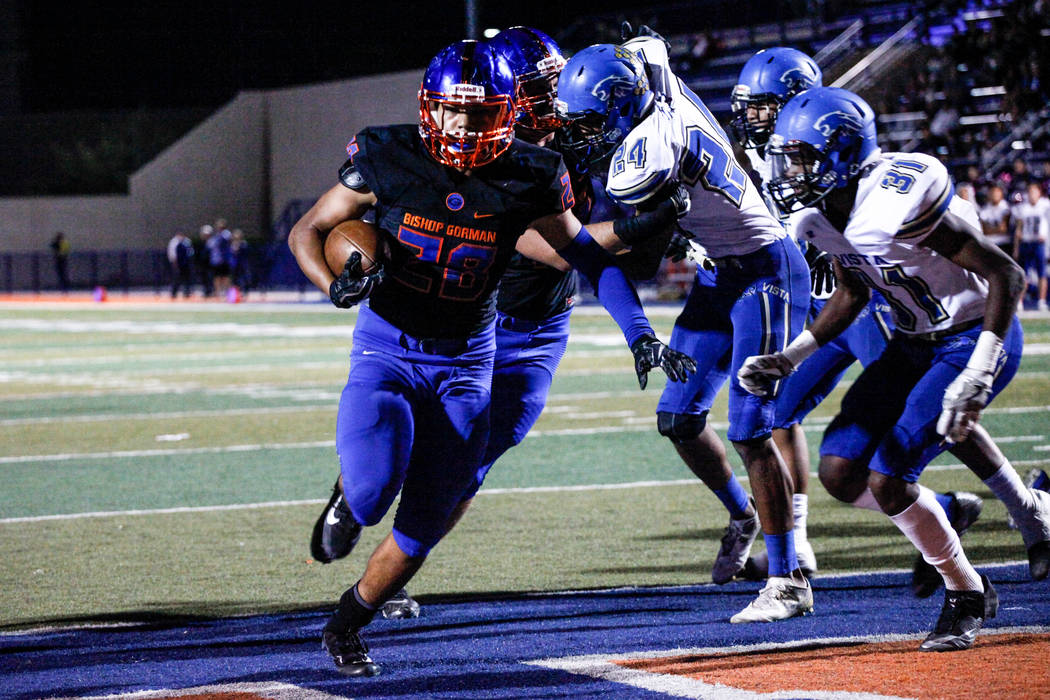Bishop Gorman's Amod Cianelli (28), left, runs the ball for a touchdown against Sierra Vista during the first quarter of a football game at Bishop Gorman High School in Las Vegas, Thursday, Oct. 2 ...