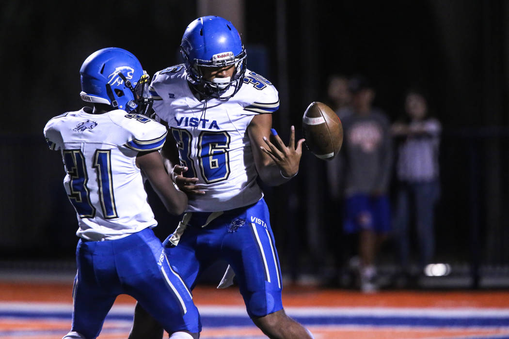 Sierra Vista's T.J. Williams (31), left, and Kaika Faatiliga (36), right, juggle the ball in a kick return against Bishop Gorman during the first quarter of a football game at Bishop Gorman High S ...