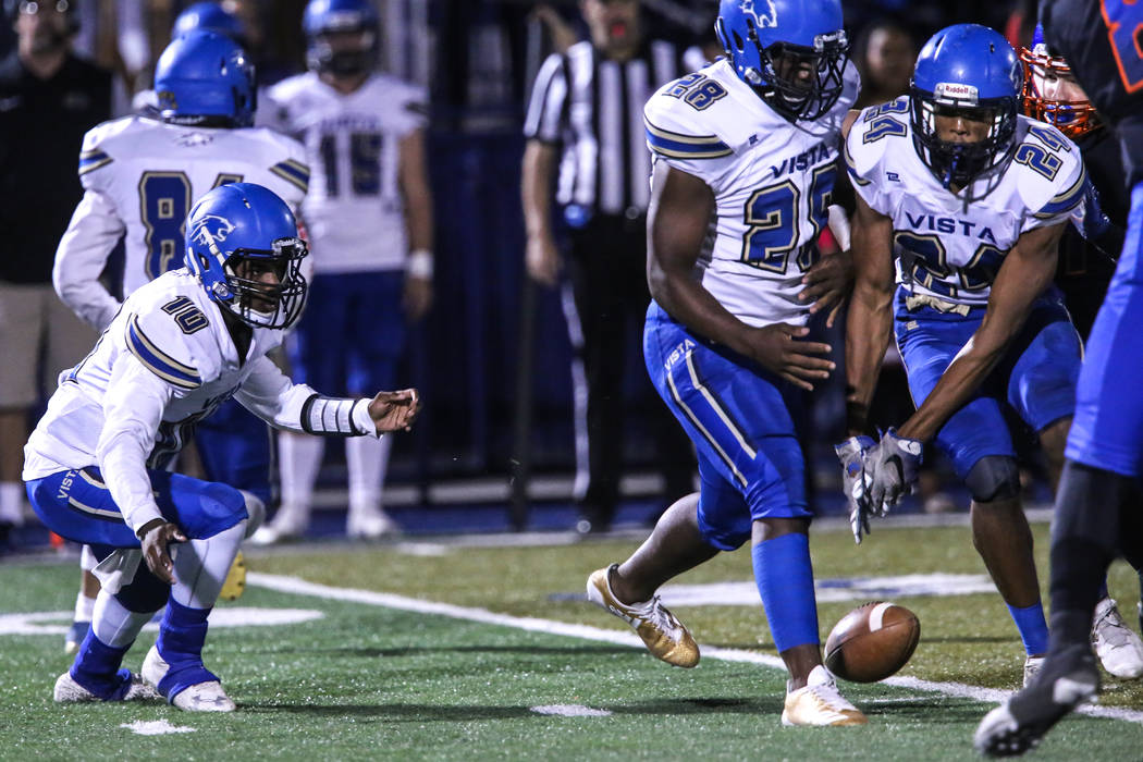 Sierra Vista's Larry Armstrong Jr. (10), left, fumbles the ball against Bishop Gorman during the second quarter of a football game at Bishop Gorman High School in Las Vegas, Thursday, Oct. 26, 201 ...