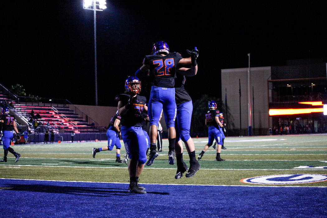Bishop Gorman's Amod Cianelli (28), center, celebrates after scoring a touchdown against Sierra Vista during the second quarter of a football game at Bishop Gorman High School in Las Vegas, Thursd ...