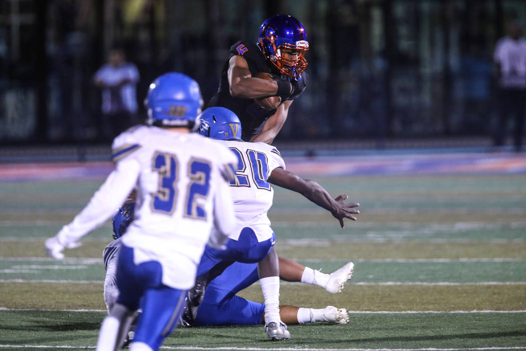 Bishop Gorman's Cedric Tillman (4), right, is tackled by Sierra Vista during the second quarter of a football game at Bishop Gorman High School in Las Vegas, Thursday, Oct. 26, 2017. Joel Angel Ju ...