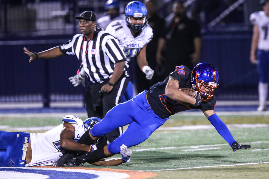 Bishop Gorman's Amod Cianelli (28), right, is tackled by Sierra Vista during the third quarter of a football game at Bishop Gorman High School in Las Vegas, Thursday, Oct. 26, 2017. Bishop Gorman  ...