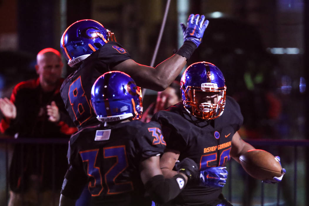 Bishop Gorman's Isaac Tuia (60), right, celebrates with teammates after scoring a touchdown against Sierra Vista during the third quarter of a football game at Bishop Gorman High School in Las Veg ...