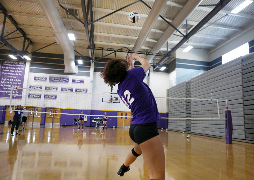 Durango High School senior Naomi Harris, 12, hits the ball during varsity practice at Durango High School in Las Vegas, Thursday, Oct 26, 2017. Elizabeth Brumley Las Vegas Review-Journal @EliPageP ...