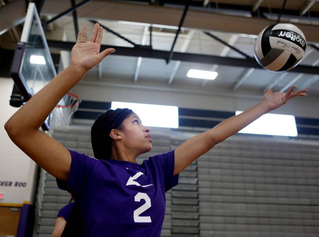 Durango High School Freshman Jaqueline Robinson serves the ball during varsity practice at Durango High School in Las Vegas, Thursday, Oct 26, 2017. Elizabeth Brumley Las Vegas Review-Journal @Eli ...