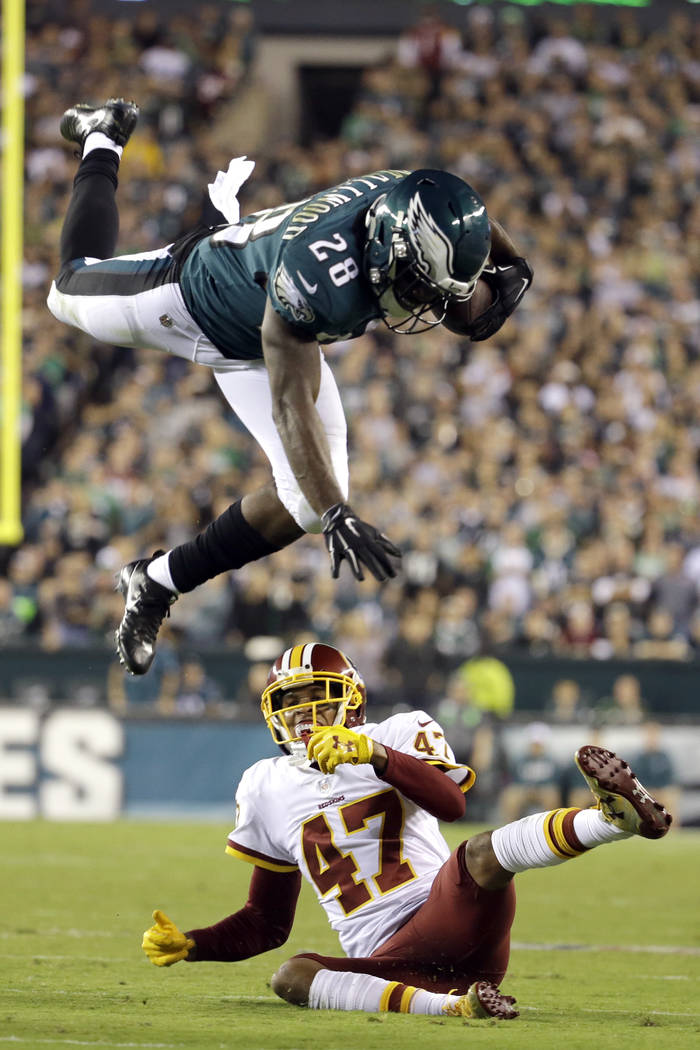Philadelphia Eagles running back Wendell Smallwood (28) goes airborne while trying to avoid a tackle by Washington Redskins cornerback Quinton Dunbar (47) during the first half of an NFL football  ...