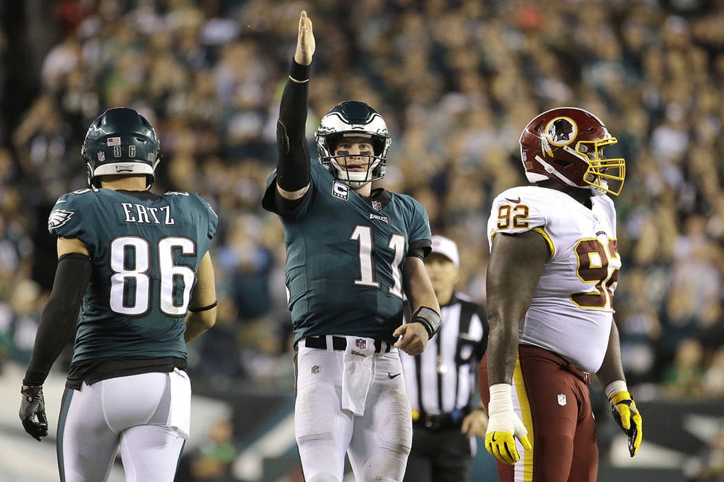 Philadelphia Eagles quarterback Carson Wentz (11) gestures after scrambling for yardage against the Washington Redskins during the second half of an NFL football game, Monday, Oct. 23, 2017, in Ph ...