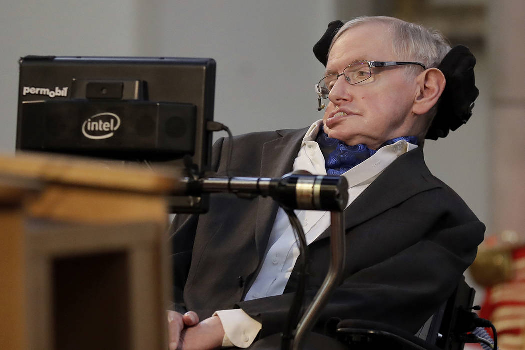 In this Monday, March 6, 2017 file photo, Britain's Professor Stephen Hawking receives the Honorary Freedom of the City of London during a ceremony at the Guildhall in the City of London. Cambridg ...