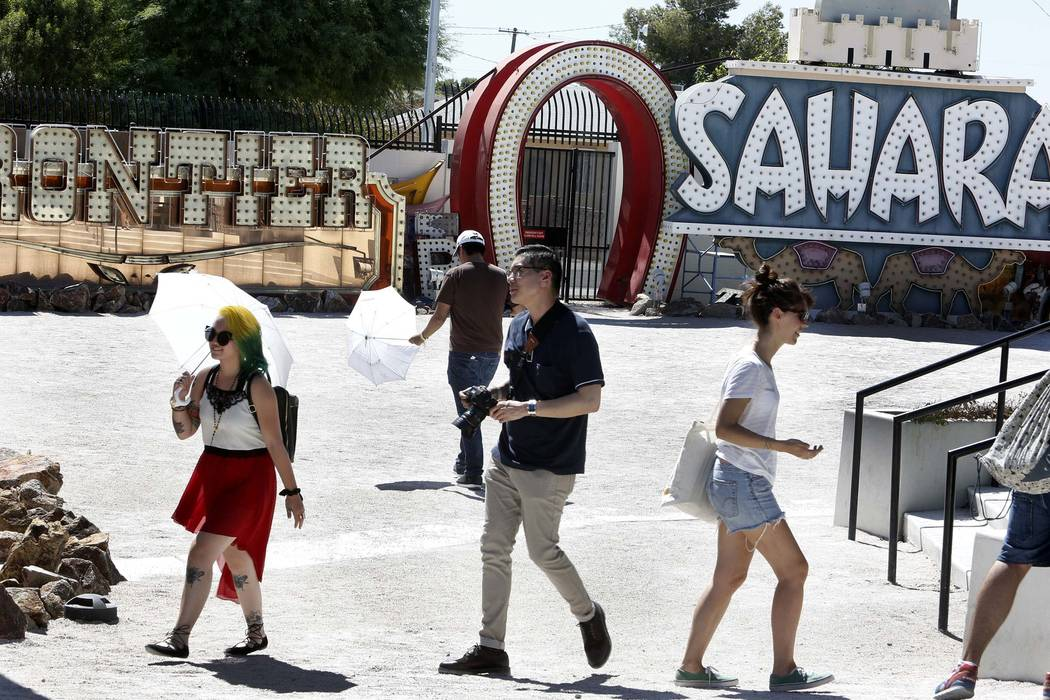 Tourists visit the Neon Museum in Las Vegas. (Bizuayehu Tesfaye/Las Vegas Review-Journal) @bizutesfaye