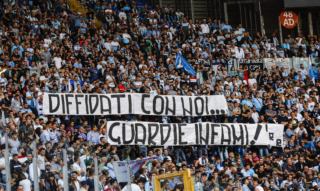 "In this Oct. 1, 2017 file photo, Lazio fans display a banner reading in Italian ""Banned fans with us, vile cops"" during a Serie A soccer match between Sassuolo and Lazio at the Olympic stadium in  ..."