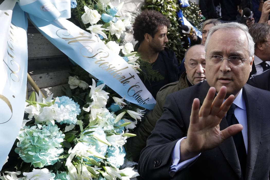 Lazio soccer team president Claudio Lotito gives a statement to the press after laying a wreath outside Rome's Synagogue, Tuesday, Oct. 24, 2017. Lazio fans have a long history of racism and anti- ...