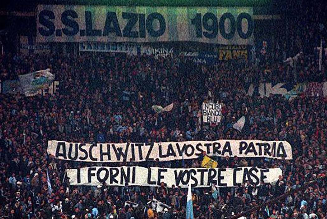 "In this Nov. 29, 1998 file photo, Lazio fans display banners from the stands reading ""Auschwitz is Your Homeland. The Ovens are Your Homes"" during a Serie A match between Lazio and AS Roma, at Rom ..."