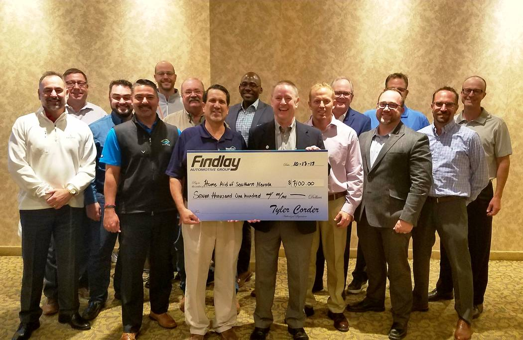 Findlay Automotive Southern Nevada Home Builders Association Executive Director Nat Hodgson, left, receives a donation of $7,100 for the association's HomeAid of Southern Nevada chapter from Fin ...