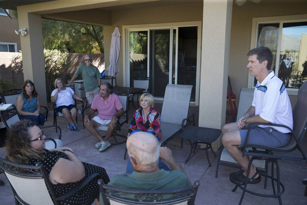 Residents at Silverstone Ranch discuss the closure of their community's golf course at one of their homes in Las Vegas, Tuesday, Oct. 24, 2017. Erik Verduzco Las Vegas Review-Journal @Erik_Verduzco