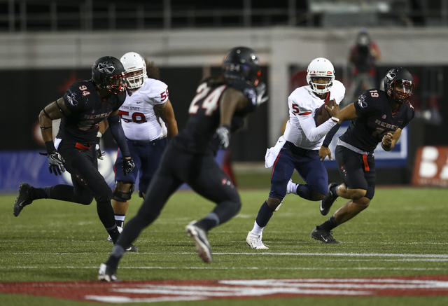 Fresno State quarterback Chason Virgil (5) runs the ball against UNLV during a football game at Sam Boyd Stadium in Las Vegas on Saturday, Oct. 1, 2016. UNLV won 45-20 against Fresno State. Chase  ...