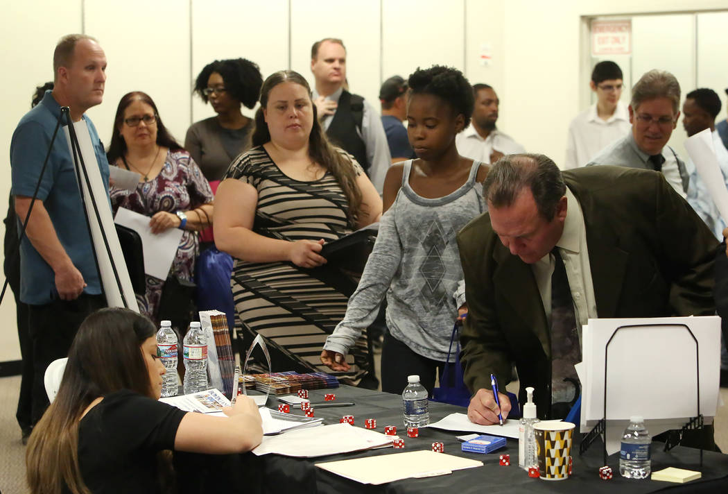 Job seekers, including Jennifer Alvarado, center, lined up during the Nevada Day Super Hiring Event on Wednesday, Oct. 25, 2017 at the Boulevard Mall in Las Vegas. Bizuayehu Tesfaye Las Vegas Revi ...