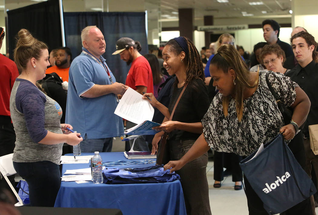 Megan Niblo, left, a recruiter with Allegiant Air, speaks to Latasha Jones, center, during the Nevada Day Super Hiring Event on Wednesday, Oct. 25, 2017 at the Boulevard Mall in Las Vegas. Bizuaye ...