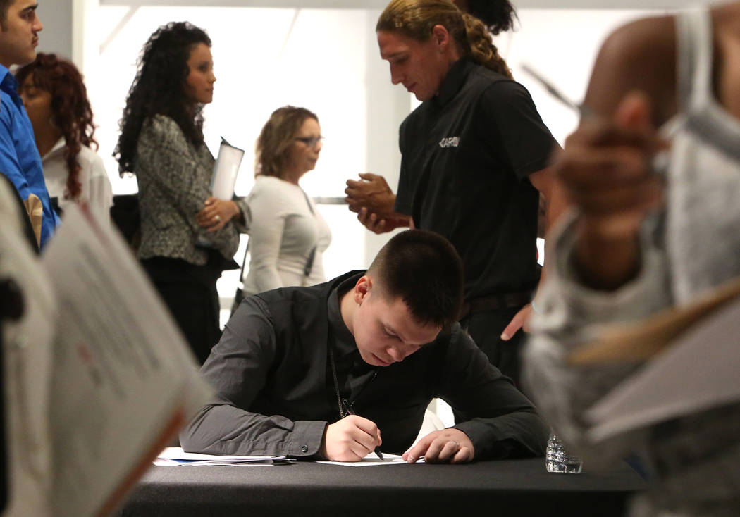 Josh Pullman fills out his job application form during the Nevada Day Super Hiring Event on Wednesday, Oct. 25, 2017 at the Boulevard Mall in Las Vegas. Bizuayehu Tesfaye Las Vegas Review-Journal  ...