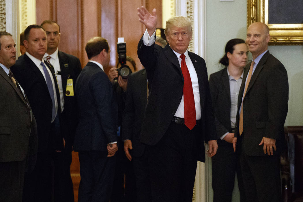 President Donald Trump waves to reporters after a lunch with Republican senator at the U.S. Capitol Tuesday, Oct. 24, 2017, in Washington. (Evan Vucci/AP)