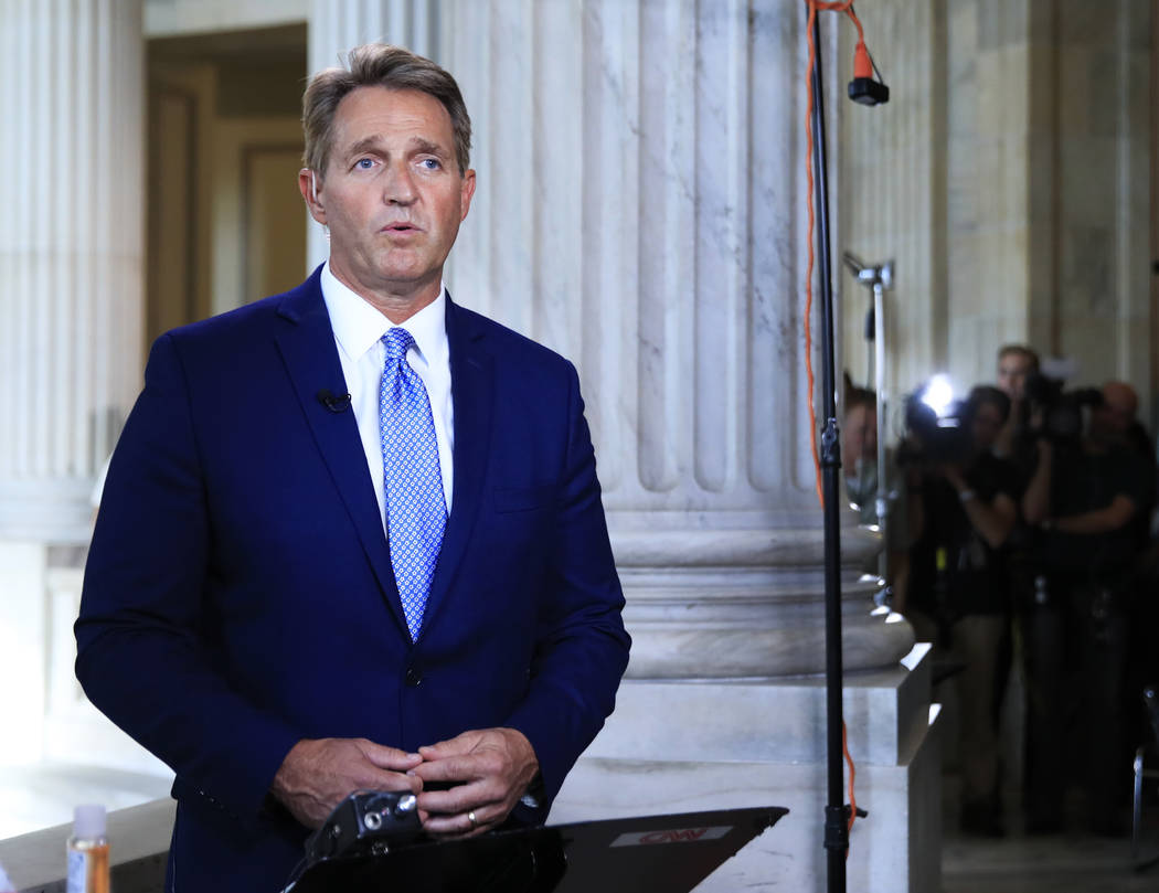 Sen. Jeff Flake, R-Ariz., speaks during a television interview on Capitol Hill in Washington, Tuesday, Oct. 24, 2017. Flake announced he would not run for re-election in 2018, condemning in a spee ...