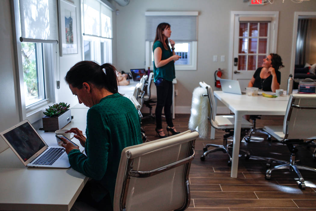 Ginger Melien, 40, of Las Vegas, a co-owner of Bloom, left, works inside the coworking space for women in Las Vegas, Tuesday, Oct. 24, 2017. Joel Angel Juarez Las Vegas Review-Journal @jajuarezphoto