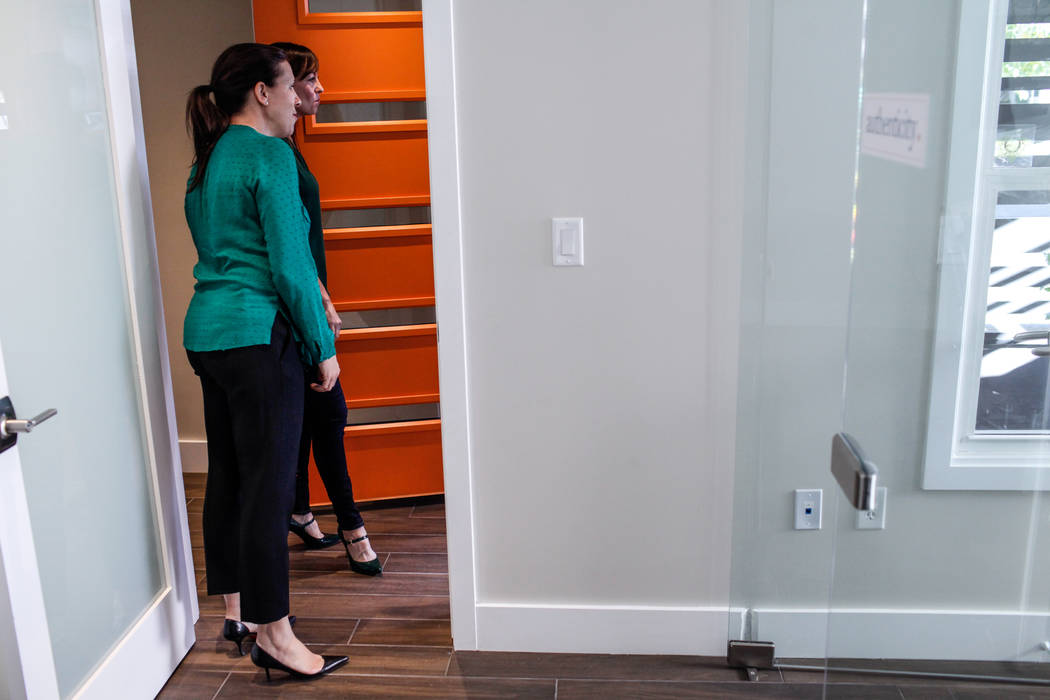 Co-owners of Bloom Ginger Melien, 40, left, and Chelli Wolford, 44, right, open the door for women interested in the new coworking space at Bloom in Las Vegas, Tuesday, Oct. 24, 2017. Joel Angel J ...
