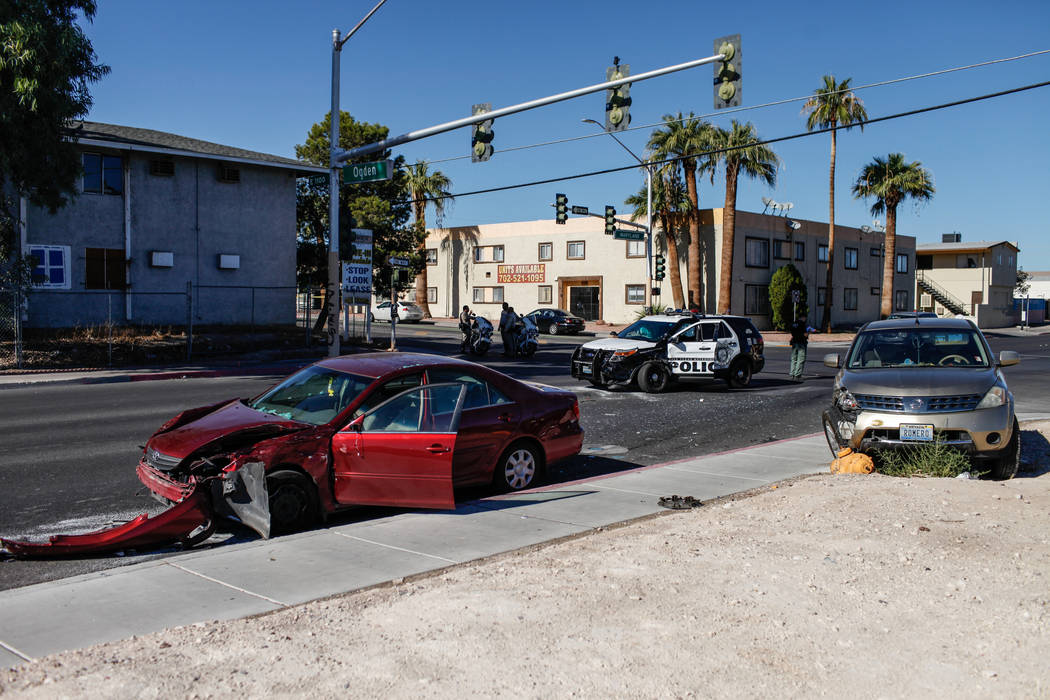 Las Vegas police investigate the scene of a three-vehicle collision involving a Metropolitan Police Department car at the intersection of Ogden Avenue and Maryland Parkway Tuesday, Oct. 24, 2017.  ...