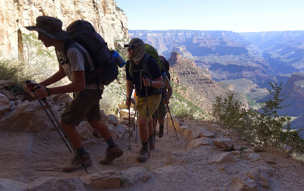 FILE - In this July 27, 2015, file photo, a long line of hikers head out of the Grand Canyon along the Bright Angel Trail at Grand Canyon National Park, Ariz. The National Park Service is floating ...