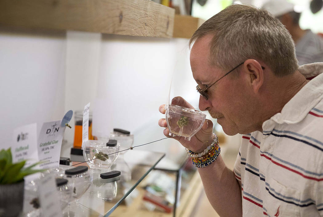 Las Vegas resident Kris Counts sniffs the cannabis on display before making a purchase at The Source cannabis dispensary in Henderson on Friday, Oct. 20, 2017. Richard Brian Las Vegas Review-Journ ...