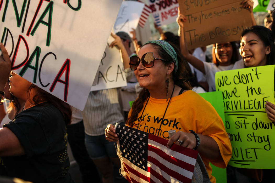 Several hundred Deferred Action for Childhood Arrival program (DACA) recipients and supporters including Erin Adams march down the Strip in Las Vegas, Sunday, Sept. 10, 2017, to call on President  ...