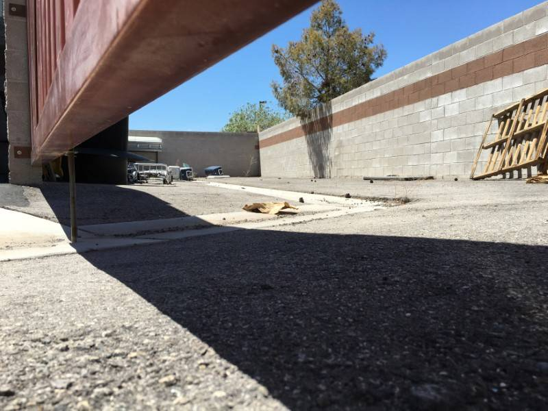 A coffin, mops and coolers used to transport body parts lie in an abandoned courtyard outside a warehouse once shared by a funeral home and the body broker Southern Nevada Donor Services  in subur ...