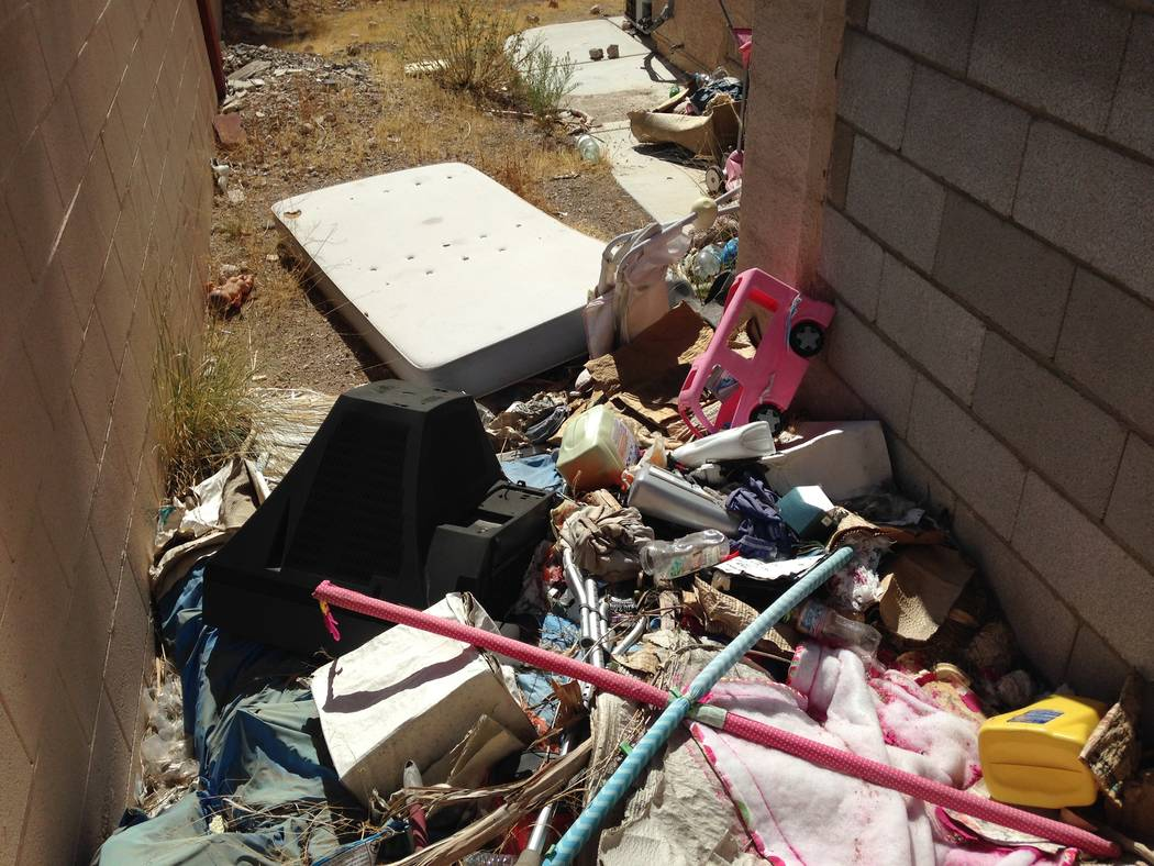 The backyard of an abandoned house near Buffalo Drive and Lake Mead Boulevard in Las Vegas is seen on Thursday, Oct. 12, 2017. (Eli Segall/Las Vegas Review-Journal)