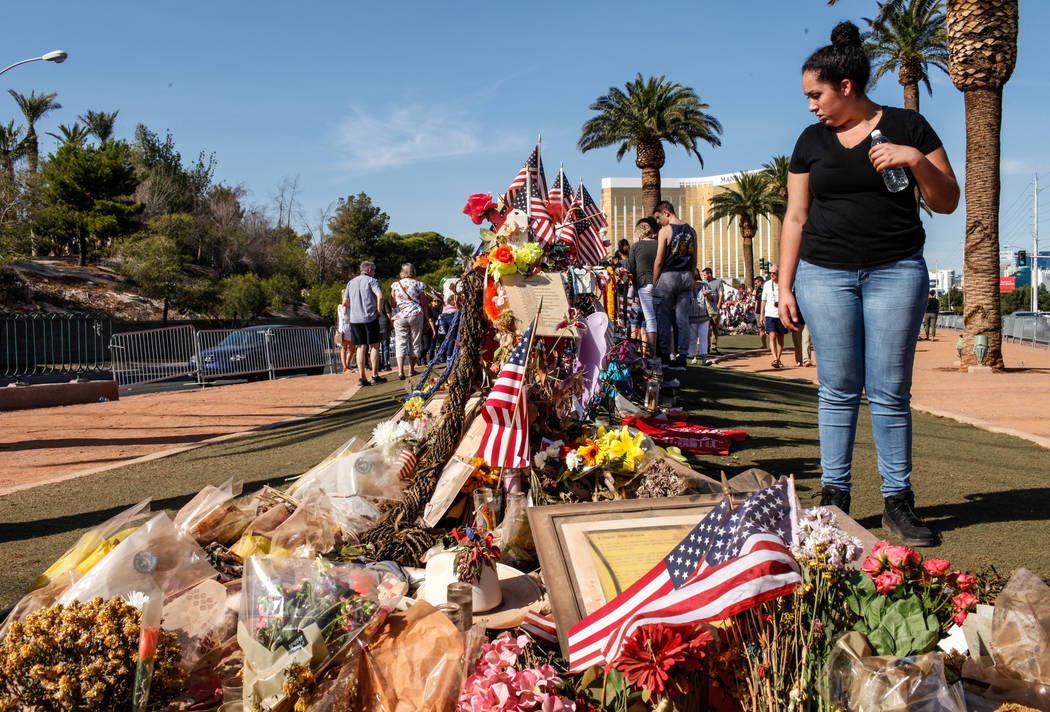 Aubriauna DeCicco of Las Vegas, 17, visits a memorial at the Welcome to Fabulous Las Vegas sign in Las Vegas, Monday, Oct. 16, 2017, honoring the victims of the Route 91 Harvest Festival mass shoo ...