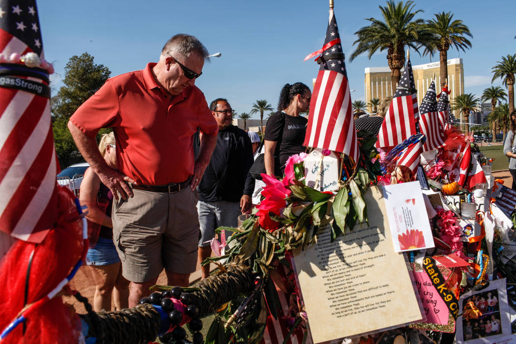 Steve Adams of Colorado and Henderson, 68, visits a memorial at the Welcome to Fabulous Las Vegas sign in Las Vegas, Monday, Oct. 16, 2017, honoring the victims of the Route 91 Harvest Festival ma ...