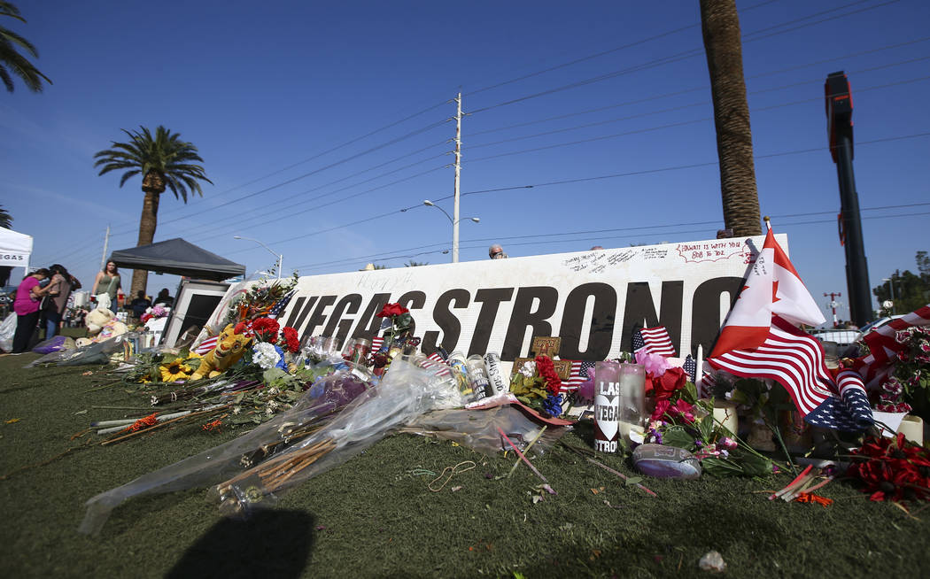 "People visit a makeshift memorial near the ""Welcome to Fabulous Las Vegas"" sign in Las Vegas on Friday, Oct. 13, 2017. Chase Stevens Las Vegas Review-Journal @csstevensphoto"